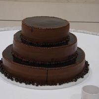 Mocha Groom's Cake This was a chocolate cake with a mocha buttercream. Topped with chocolate ganache and had chocolate covered coffee beans around it. The...