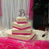 Square Wedding Cake Square cake sizes, 6, 9, 12, 15. Hot pink and orange flowers were added to this cake before the wedding.