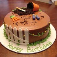 "Garden Cake 10"" chocolate cake with fondant accents, crushed oreos for dirt"