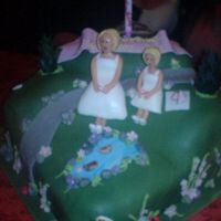 Landscaped Birthday Cake   Made this using sponge cake, covered in green sugarpaste and decorated to resemble my mum and my daughter in the park they like to visit!