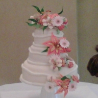 Maggies Cake1 Thses are gumpaste flowers.....12in...8in...6 in rounds.....with fondant.