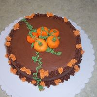 Fall Leaves And Pumpkins Chocolate BC icing with fondant pumpkins with BC leaves and vines. Was inspired to make this cake with multiple ideas from this website,...