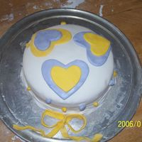 Purple And Yellow Hearts,fondant mmf.Strawberry cream cheese.All mmf 9in 2 layer.Braided border!No classes for this just some help from my aunt.I do start a class in 2...