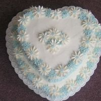Heart Daisy Cake This Cake was made with Butter Cream Icing and Gum Tex and Fondant Daisies...Real Easy Cake