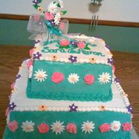 Peonies / Square Wedding Shower  Each square cake is 2 layers. All frosted in buttercream. The peonies are made with MMF the other flowers are Royal icing. I promise the...