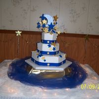 The Moon And The Stars Wedding Cake The bride asked for the moon and the stars on her cake. Gold and celtic blue were the colors use. The stars and the moon were made from a...