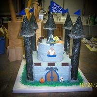 Halloween Castle Cake is covered with buttercream icing. Turrets are made of cardboard and covered with royal icing and sanding sugar. Figures formed from...