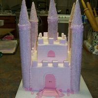 Princess Castle Cake Cake is covered in buttercream. Towers are cardboard tubes frosted with royal icing and sanding sugar. Fondant was used for accents. The...