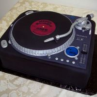 Turntable Birthday Cake Copied the design of the actual turntable the birthday person was getting as a gift. Everyone, especially the recipient, absolutely loved...