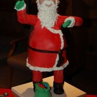 "Santa Cake From Bronwyn Weber Class I made this cake in a class taught by Bronwyn Weber. Legs and arms are modeling chocolate. Body is four 8"" rounds carved. Head is..."