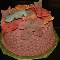 Basket Of Leaves Chocolate fudge cake with Peanut Butter filling and frosting. Gumpaste leaves.