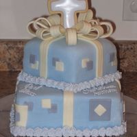 God Bless   First Communion cake covered in MMF with chocolate clay details. Cookie cross.