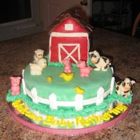 Baby Farm Animals I had a request for a baby farm animals baby shower cake... The cake is covered in MMF with all the animals made of chocolate clay. The...