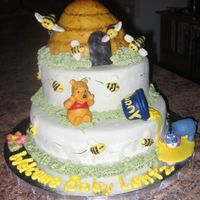 "Pooh Baby Shower  Pooh Baby shower cake is covered in MMF with royal icing ""grass"" to help support the layers. The beehive is made of Rice Krispie..."