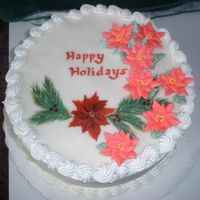 Painted Poisettias Learning how to use royal icing and tried poinsettias along with my painted plaque.