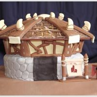 World Of Warcraft  A friend of mine requested this cake for his fiance, based on a building from her favorite game - World of Warcraft. Chocolate Amaretto...