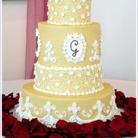 Monogrammed Wedding Cake What a cake! Made from a picture the bride tore out of a magazine - I'm sorry I have no idea who made the original, but they deserve...