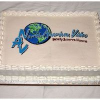 Full Sheet Logo Cake  This was huge! It fed 100 people, half white and half chocolate. They wanted their logo reproduced on top, but NOT an edible image. This is...