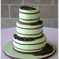 Green With Stripes Three tiers covered in green fondant (I haven't had much experience working with fondant, so it was a challenge!). Chocolate fondant...