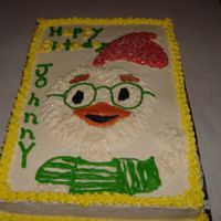 Chicken Little hand drawn chicken little , white sheet cake butter cream icing. It was for my nephew's birthday.
