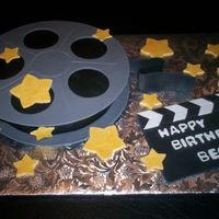 Movie This cake was done for a friends Hollywood party. All dec. are fondant.
