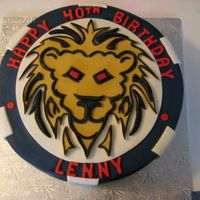 Img_0104.jpg the client has a poker consulting company and he wanted a cake to look like a poker chip and have his logo, the lion, on it..it was really...
