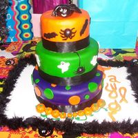Girls Halloween Birthday Cake I made this for a girls Birthday/ Halloween party. I had made a really pretty bow to put on top and it fell apart when I was going to put...