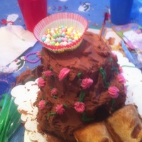 The Castle Our 4 and 8 year old granddaughters made this out of some leftover layers and such from my last project. They were limited in icing colors...