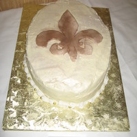 Fleur-De-Lis White chocolate and lemon cake with white chocolate and lemon cream cheese icing. Fleur-de-lis is MMF painted with lustre dust.