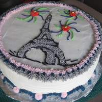 Eiffel Tower WASC with buttercream. Piping gel transfer for tower. Thanks to all the CC'ers who gave me the idea...I intended to make it much more...