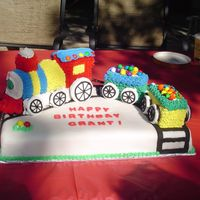 Train Cake  This was one of my first cakes I got paid for. I did it about a year ago. It was tough to do but so much fun when its for your son's...