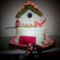 Birdhouse Buttercream birdhouse and cake. Almond cream cheese pound cake. Royal icing roses.