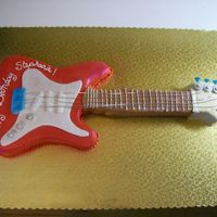 Guitar Cake This was fun for my first guitar, a few things I will do differently next time, made with MMF and gumpaste accents