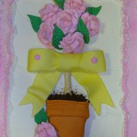Mothers Day Topiary Topiary, Royal Icing Roses, Fondant bow and leaves. Got the idea from American Cake Decorating