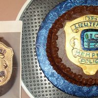 Memorial Cake This is a Yellow Cake with Strawberry filling and Chocolate Syrup Icing. The decoration is a replica of a police badge (pictured to the...