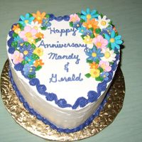 Anniversary Cake  WBSC cake with chocolate buttercream filling and whipped buttercreamicing. The flowers are royal icing. Very pleased with the cake except...