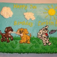 Doggy Birthday Cake Strawberry cake with Cream Cheese Icing. This cake is for a 7 year old who knew exactly what he wanted on his cake: 2 puppies playing tug...