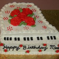 Piano Birthday  This is a white cake with white icing. Done for a friend who saw a cake done by bolo and wanted one like it. Thanks for the inspriation. I...