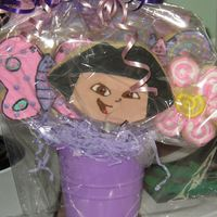 Dora Cookie Bouquet This is NFSCs with Antonia's icing. Dora, Butterflies and Flowers for a friend's grandaughter.