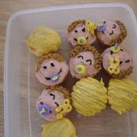 Babyhead Mini Cupcakes I had extra mini cupcakes (they were the belly in the bump cake) and I had extra frsoting (I always make too much frosting)Thanks to all...
