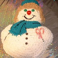 School Colors Snowman A Christmas cake made for the teachers at my daughters school. Their school colors are teal and white. Brown sugar chocolate cake with...