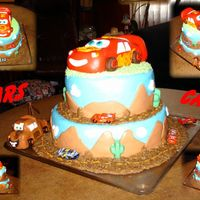 Cars Cake McQueen and Mater were made from rice cereal treats covered with MMF. Bottom layer is Chocolate Chocolate Chip layered with Hazelnut cake...