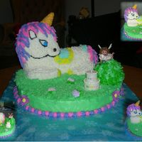 Unicorn & Fairy Unicorn made from 3D Lamb pan and cake pieces for legs, is Chocolate Chocolate Chip cake with Nutella Filling. Bottom is a 14 in. White...
