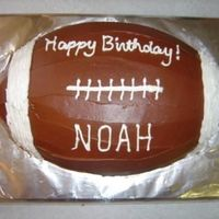 Football Made this with the wilton football pan for my son's first birthday