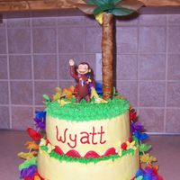 Curious George Luau Curious George is a toy, banana tree made covering dowel rods in gumpaste, leaves are made from tissue paper. Lei is store bought, all...