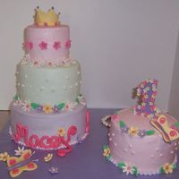 Princess Cake   Buttercream frosting and gumpaste accents. The smaller cake is egg free... tiered cake a regular white cake.