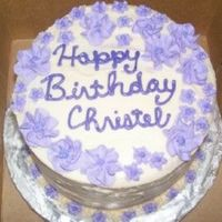 "Royal Icing Flowers B-Day Cake  Customer said she wanted lots of flowers -- this was a 6"" 2 layer round cake. My fav. part is the border. I piped star flowers around..."