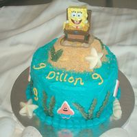 Sponge Bob Cake For my son's birthday. Very simple cake, iced in buttercream. White chocolate shells, etc. The Spongebob is actually a candle I found...