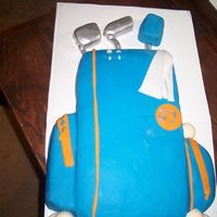 Golf Cake Made this cake for my hubby's birthday. He is a golf fanatic. All fondant, golf balls were melted chocolate in golf ball molds. I...