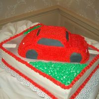 Auto Groom's Cake All buttercream, tires were fondant icing, road was airbrushed. Fun, but those stars were tedious!